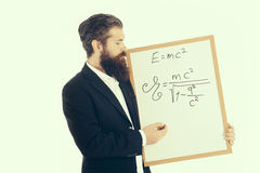 Bearded man with einstein formula and newtons law Royalty Free Stock Photo