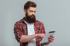 Bearded man with gadget Stock Photo