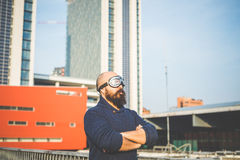 Bearded man with glasses aviator. In the high city Stock Images