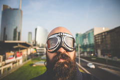 Bearded man with glasses aviator. In the high city Royalty Free Stock Photography