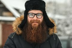9fa1222097d Bearded man in glasses and a black cap in real life. royalty free stock  images