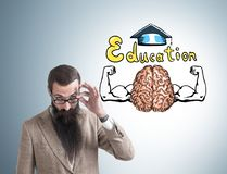 Bearded man in glasses, education, brain Royalty Free Stock Photo