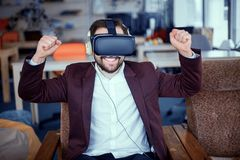 Adult bearded man wearing virtual reality vr glasses stock photo