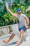The bearded man in goggles astride the toilet, which is installe Stock Photo