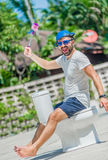 The bearded man in goggles astride the toilet, which is installe Royalty Free Stock Photos
