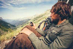 Bearded Man with gps navigator tracker relaxing. Alone Travel Lifestyle concept mountains and clouds on background Summer adventure vacations outdoor stock images
