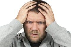 Bearded man grabbed his head Stock Photography