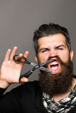 Bearded man with hairdresser scissors Royalty Free Stock Photography