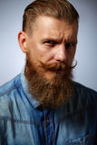 Bearded man. Handsome man with a beard and twirled mustache. Royalty Free Stock Photos