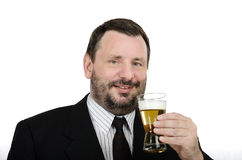 Bearded man has a drink lager. Bearded man in black suite has a drink lager glass on a white background Royalty Free Stock Photo