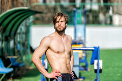 Bearded man has stylish hair, athletic body relax at stadium royalty free stock images