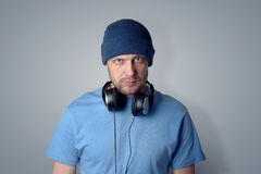 Bearded man in a hat with headphones Royalty Free Stock Photos