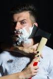 Bearded man having shaved Royalty Free Stock Photo