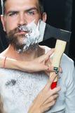 Bearded man having shaved Stock Photography