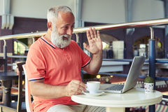 Bearded man having video chat Stock Photography