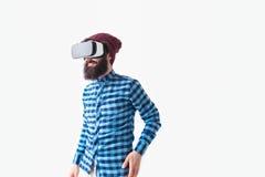 Bearded man having VR experience royalty free stock image