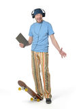 Bearded man with headphones and tablet pc on skateboard. White background. File contains a path to isolation stock image