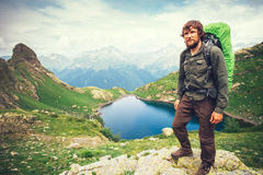 Bearded Man hiker with backpack mountaineering. Travel Lifestyle concept lake and mountains on background Summer adventure vacations outdoor stock images