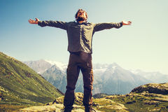 Bearded Man hiker hands raised outdoor. Travel Lifestyle happiness concept mountains landscape on background adventure vacations stock photos