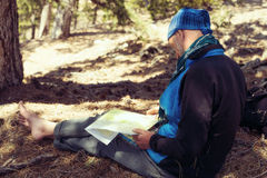Bearded man, hiker sitting with map Royalty Free Stock Photo