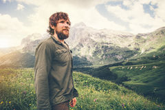 Bearded Man hiking Travel Lifestyle concept mountains on background. Summer journey adventure vacations outdoor royalty free stock photography