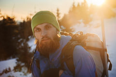 Bearded man hiking in winter mountain at sunset Royalty Free Stock Photos