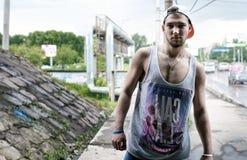 Bearded man hip hop dancer on the bridge Stock Photo