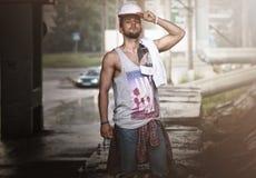 Bearded man hip hop dancer on the bridge Stock Photos