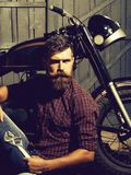 Bearded biker man with wrench royalty free stock image