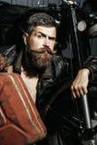 Bearded man hipster biker Royalty Free Stock Image