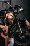 Bearded man hipster biker Royalty Free Stock Photos