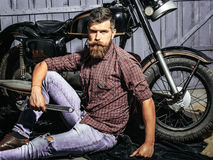 Bearded man hipster biker Stock Photography