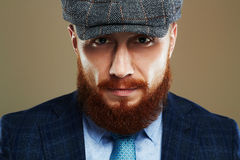 Bearded man.Hipster boy.handsome man in hat.Brutal man with red beard Stock Image
