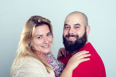 Bearded man and his wife smiling in to the camera Royalty Free Stock Image