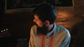 Bearded man in historical russian kosovorotka shaking in rhythm stock video