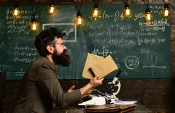 Bearded man hold books in university. Scientist research with microscope. Man with beard and mustache on chalkboard