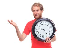 Bearded man holding big clock and pointing Stock Images