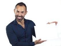 Bearded man holding a blank white canvas Stock Photos