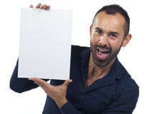 Bearded man holding a blank white canvas Royalty Free Stock Image