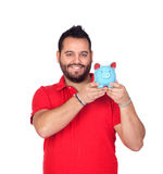 Bearded man holding a blue piggy bank Stock Images