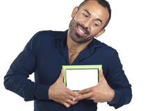 Bearded man holding empty green picture frame Royalty Free Stock Photography