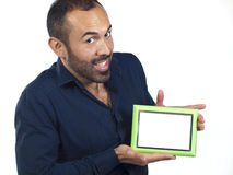 Bearded man holding empty green picture frame Royalty Free Stock Photo