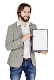 Bearded man holding a folder of document and pointing his pen at Stock Images