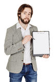 Bearded man holding a folder of document and pointing his pen at Stock Photos