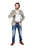 Bearded man holding a folder of document and pointing his pen at Royalty Free Stock Image
