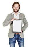 Bearded man holding a folder of document and pointing his pen at Royalty Free Stock Photos