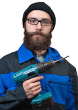 Bearded man holding in a hand the electric drill Stock Photography