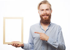 Bearded  man holding a picture frame Royalty Free Stock Photo