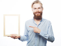 Bearded  man holding a picture frame Royalty Free Stock Images
