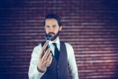 A bearded man holding a razor Royalty Free Stock Photography
